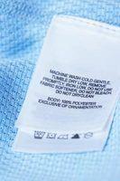 Instruções de uso para o material que é 60% poliéster, 32% rayon e 8% elastano