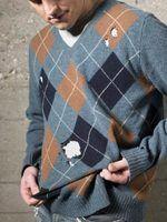 Como corrigir um buraco em uma camisola de lã
