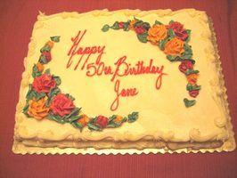 Festas de aniversário são uma forma social do celebrando alguém`s 50th birthday.