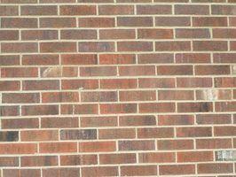 Quais são os problemas com folheado do tijolo do lado de fora de uma casa?
