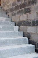 Que reações químicas ocorrem quando o concreto é feita?