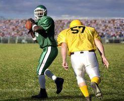 Luvas para ajudar um aperto quarterback a bola