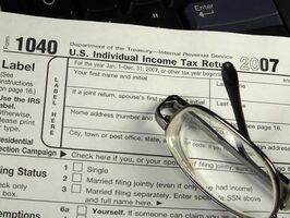 Quais as formas de imposto eu preciso fazer se eu rolar um 401k a um ira?